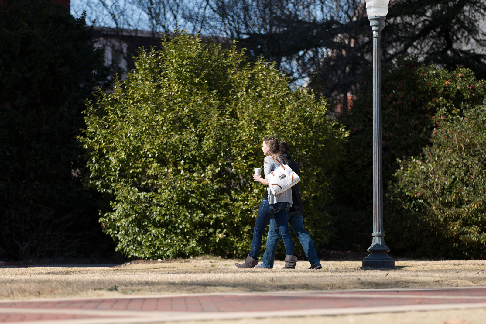 couple walking near samford hall