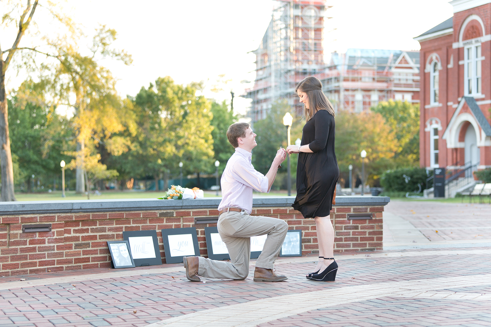 guy proposes with samford hall in the background