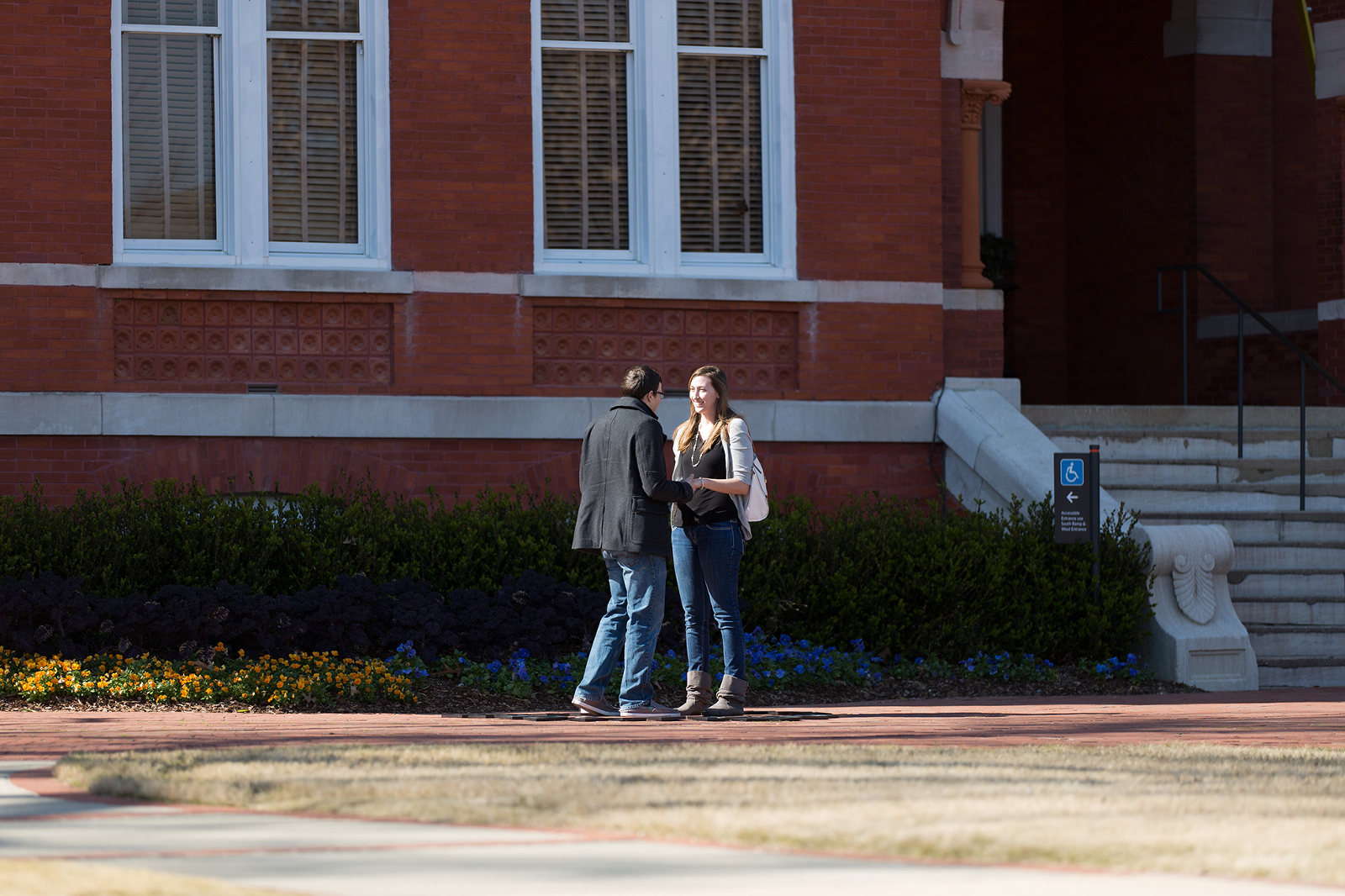 couple standing in front of samford hall