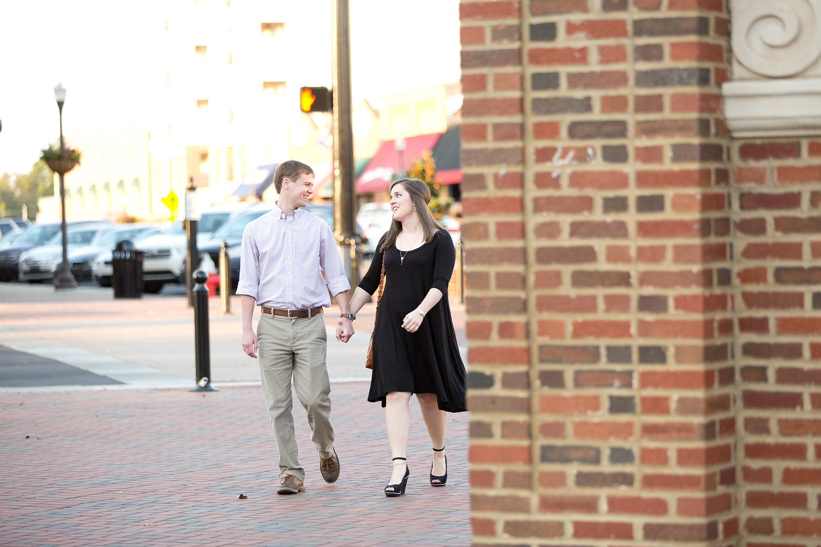 couple walk to toomer's corner in auburn