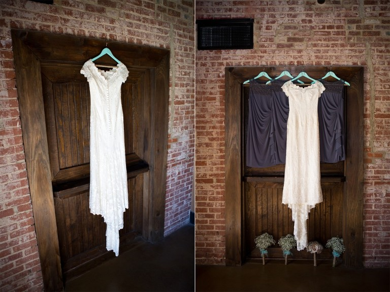 bridal gown hanging with bridesmaid dresses