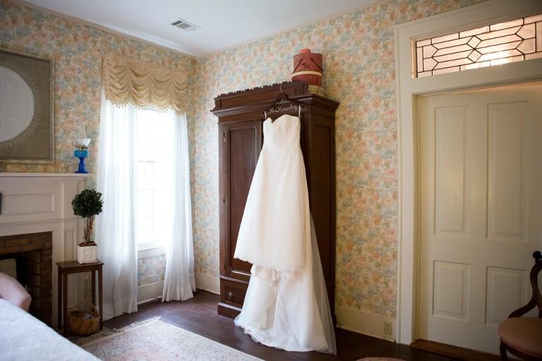 bridal gown hanging on dresser
