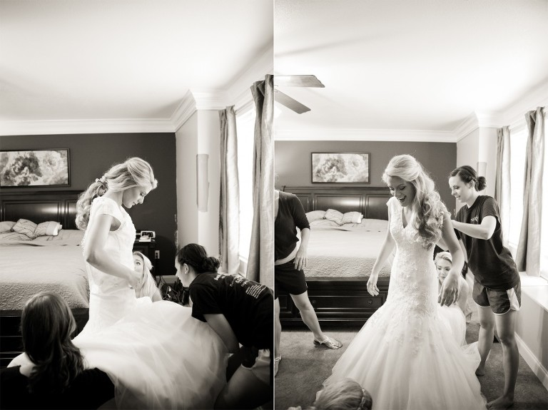 bride putting on gown