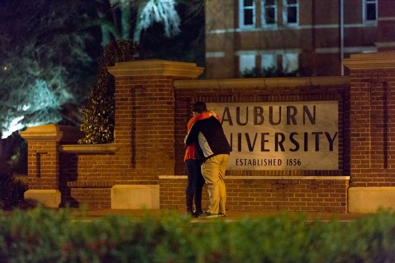couple hugs after getting engaged auburn university