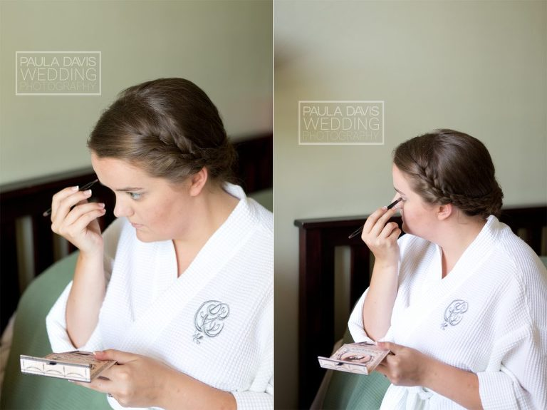 bride putting on makeup near window