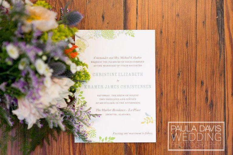 wedding invitation on wooden floors