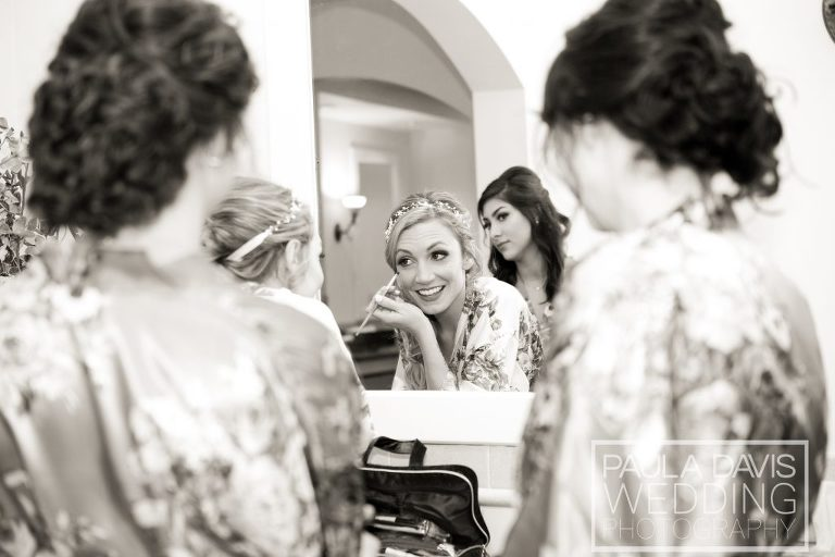 bride doing makeup