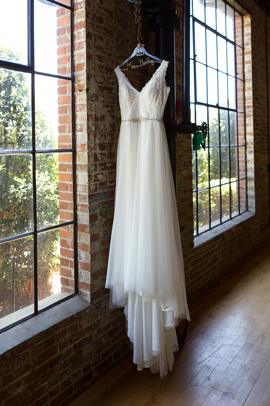 bride's dress hangs near a window at the rivermill event center in columbus
