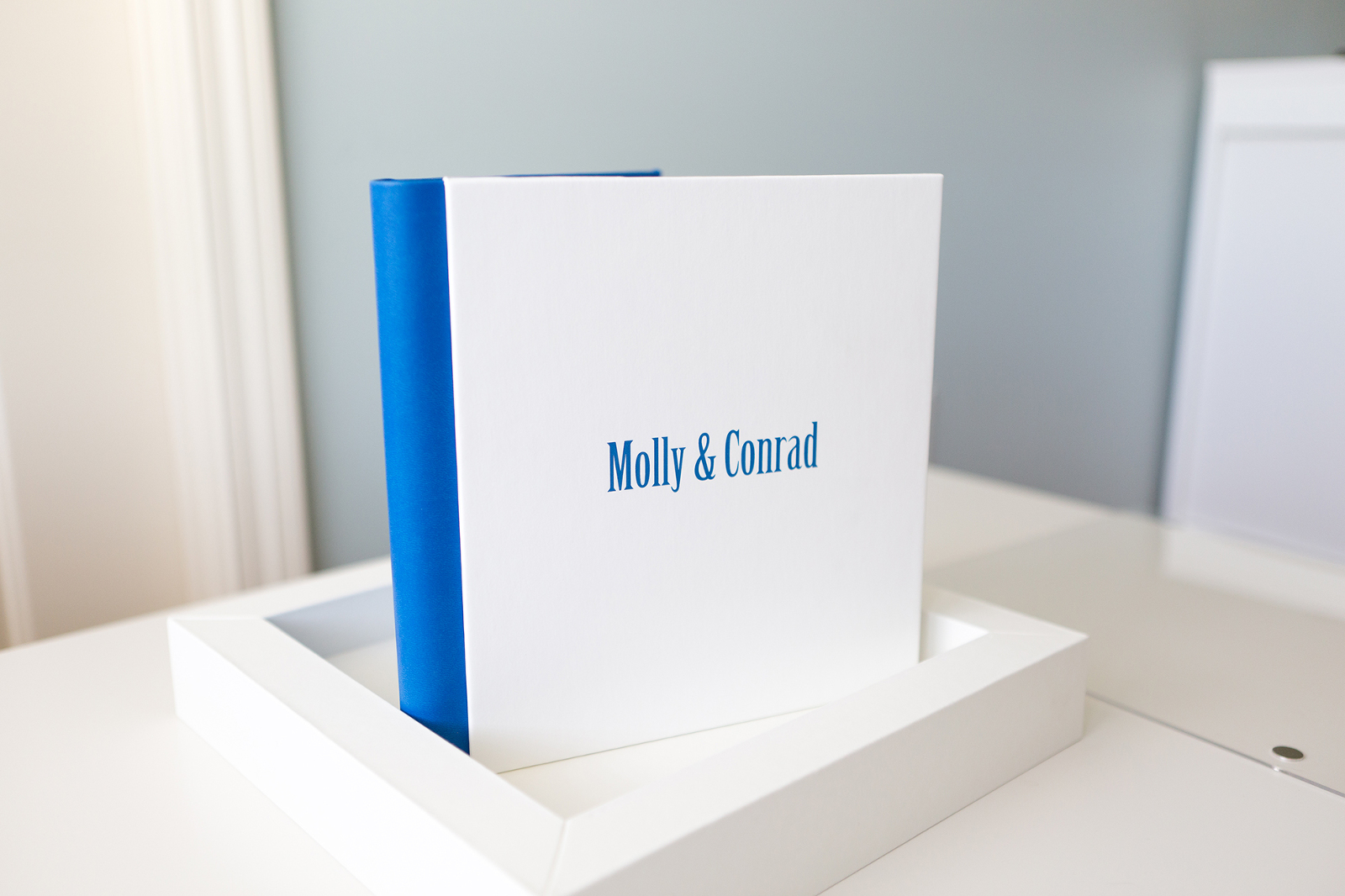 engagement album with white cover and blue spine