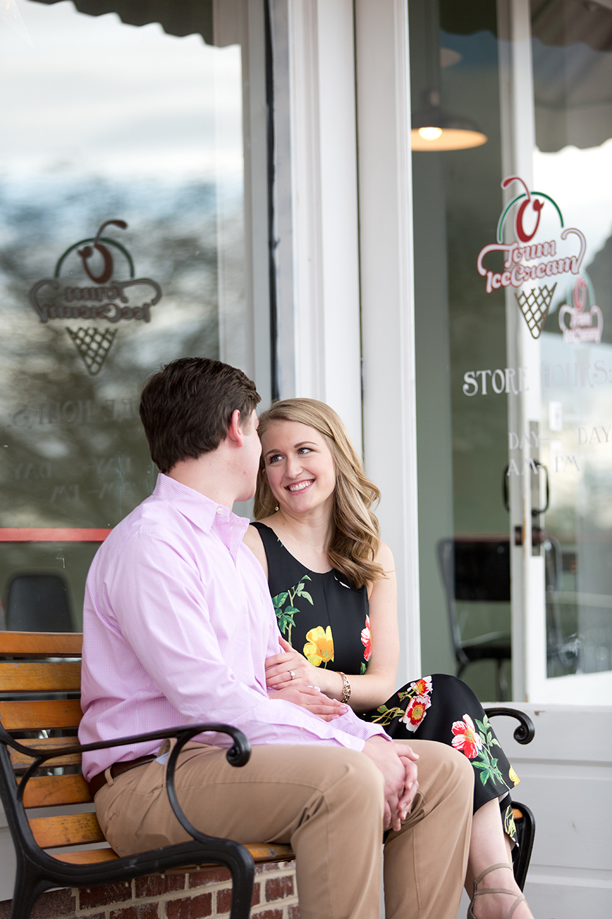 couple sitting on a bench outside o town ice cream in opelika