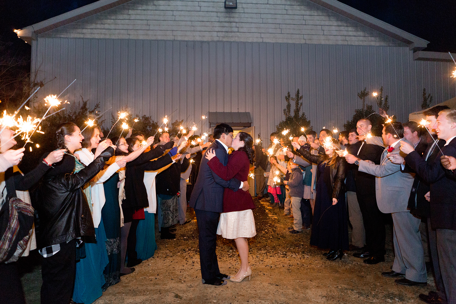 bride and groom embrace during their sparkler sendoff at lazenby farms