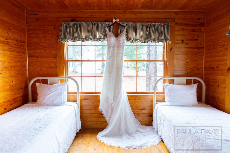 bridal gown hanging in a cabin