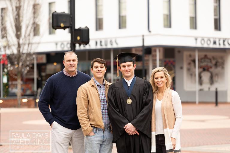 family standing at toomer's corner before graduation