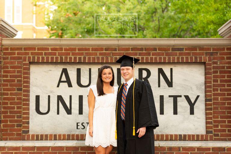 graduate with girlfriend by auburn university sign