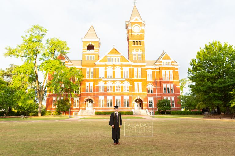 graduate in cap and gown by samford hall