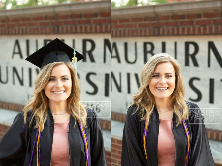 girl in cap and gown standing by the auburn university sign
